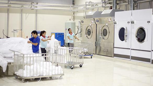 Giặt ủi đồ khách